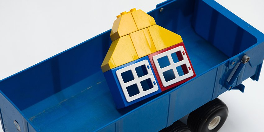Property Repossessions: house towed away in a cart