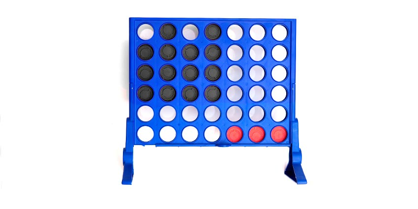 Connect four showing red and green coins representing debt and surplus