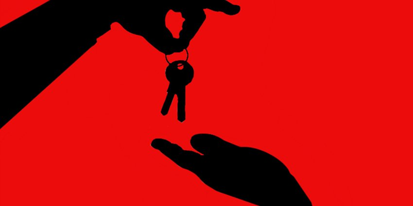 House keys exchanging between two hands: sell or rent